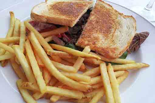 Flank steak sandwich with French fries